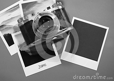 Retro vintage four instant photo frames cards on grey background with images of nature and blank photo with old camera