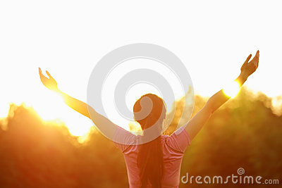 Happy Asian Chinese woman embrace nature and sun