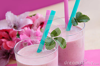 Healthy strawberry smoothie. Fresh milkshake prepared as fruity milk cocktail.