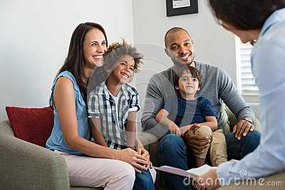 Family talking with counselor
