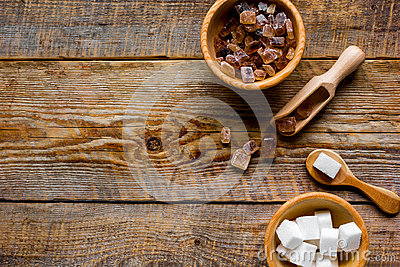 Cooking sweets set with different sugar lumps on rustic table background top view mockup