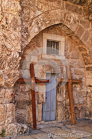 Crosses lean under an arch in the wall of the Church of the Holy Sepulcher in the Christian Quarter of the Old City of Jerusalem