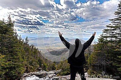 Man in praise looking out from elevation on Mount Washinton via