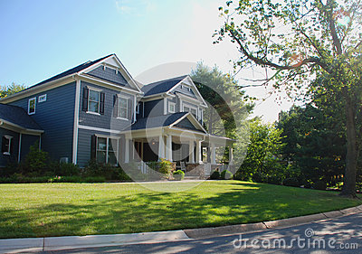 Luxury Home With Blue Siding and White Columns