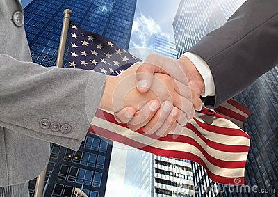 Business people shaking their hands against american flag and skyscraper