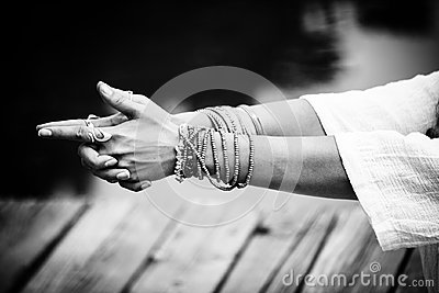 Woman hands in yoga symbolic gesture mudra bw