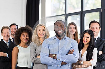 stock image of african american businessman boss with group of business people in creative office, successful mix race man leading