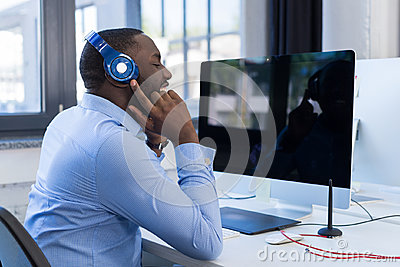 African American Businessman Listen To Music With Headphones In Modern Coworking Space, Adult Business Man Relaxing On