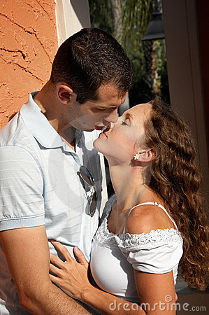 Beautiful young lovers about to kiss in the aftern