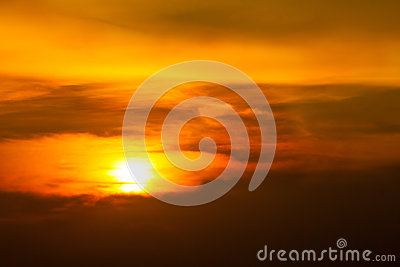 Sunrise-Sunset with clouds, light rays and other atmospheric effect.Brilliant orange sunrise over clouds with bright yellow sun on