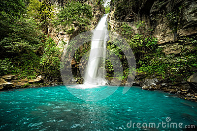 `La Cangreja` Waterfall, Costa Rica. A beautiful pristine waterfall in the rainforest jungles of Costa Rica