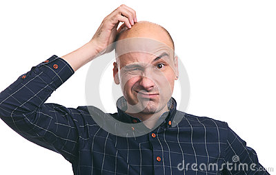 Confused bald guy scratch his head