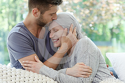 Sick woman being kissed