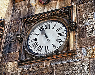 Medieval timepiece adjacent to the main door of the Prague City Hall. Czech Republic. Prague