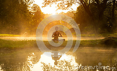 Healthy woman lifestyle exercising vital meditate and energy yoga in morning the spring nature background.