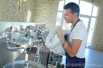Portrait brewer working at brewery factory