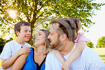 Cheerful parents spending weekend with children