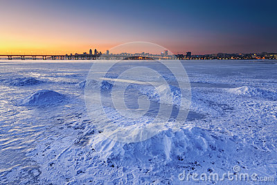 Beautiful winter landscape with frozen river at Dusk III