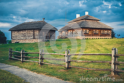 Wooden ethnic houses on rural landscape, Kossovo, Brest region, Belarus.