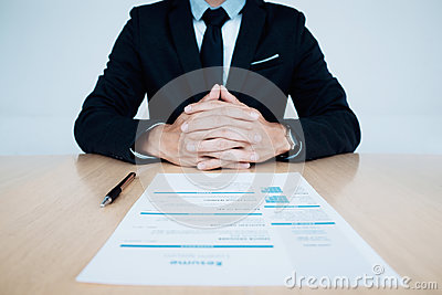 Business Job interview. HR and resume of applicant on table.