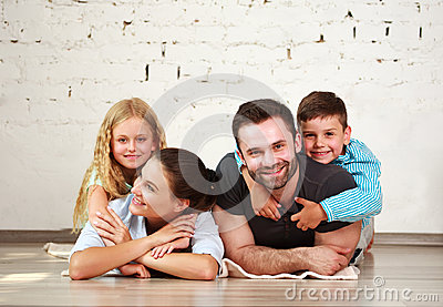 Young happy family parents and two children home studio