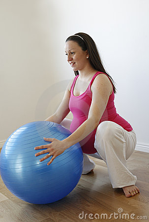 Pregnant woman doing squatting exercise