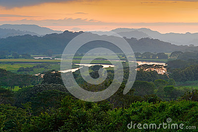 Rio Tarcoles, Carara National Park, Costa Rica. Sunset in beautiful tropic forest landscape. Meander of river Tarcoles. Hills with