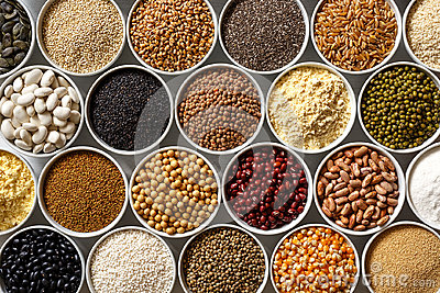 Arranged white bowls with uncooked pulses, grains and seeds on w