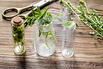 Homeopathy. Store up medicinal herbs. Herbs in glass on wooden table background