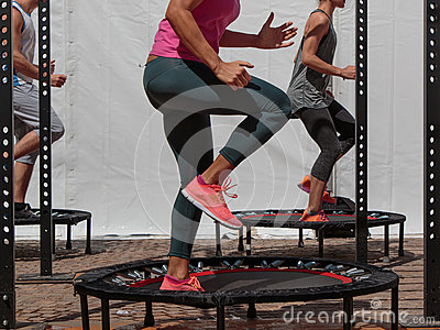 Mini Trampoline Workout: Girl doing Fitness Exercise in Class at