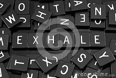Black letter tiles spelling the word & x22;exhale& x22;