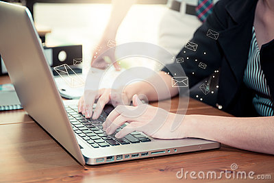 Sending email. gesture of finger pressing send button on a computer.
