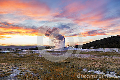 Old and faithful Geyser erupting at Yellowstone National Park