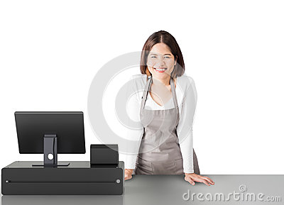 Asian worker with cashier desk