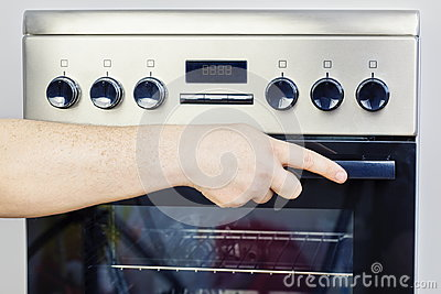 Hand on electric cooker