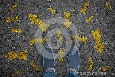 Man standing on road with many direction arrow choices or move