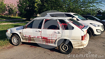 Vandalism - a modern car, doused with paint in free parking