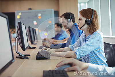 Side view of businesswoman working at call center