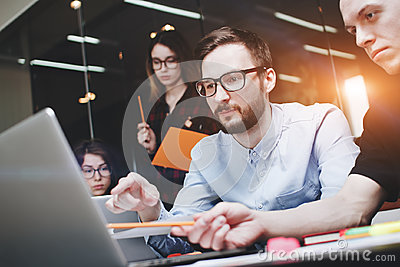 stock image of business people brainstorm concept. generic design notebook on wood table, papers, documents. team of businessmen are thinking ove