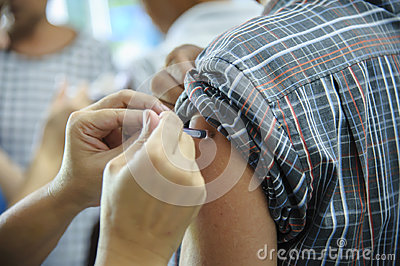 immunization vaccine injection , doctor inject vaccine to patient arm