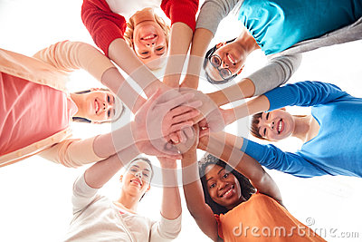 stock image of international group of women with hands together