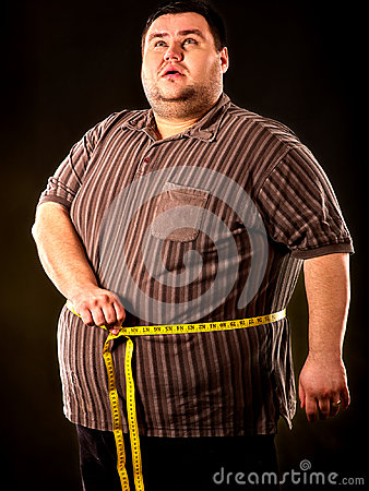 Man belly fat with tape measure weight loss around body .