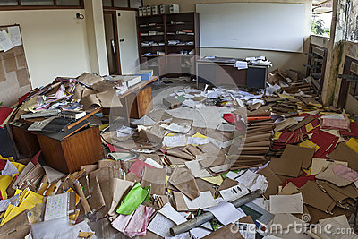 MESSY OFFICE FULL OF FOLDERS AND PAPERS