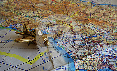 Royal Air Force flight map and brass aeroplane paperweight.