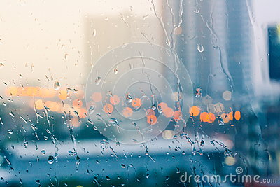 Romantic and lonesome mood near glass window in raining