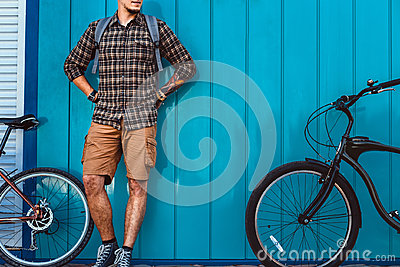 Adult Traveler Man Stands With A Bicycles Near Blue Wall Daily Lifestyle Urban Resting Concept