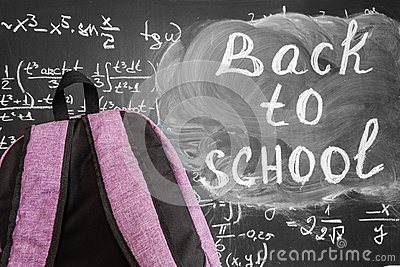 Back to school background with purple school bag and the title `Back to school` and math formulas written by white chalk