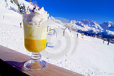 Bombardino with whipped cream on the mountain slopes