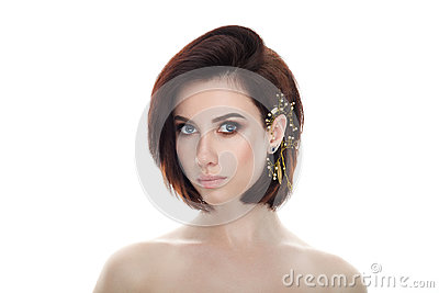Beauty portrait of adult adorable fresh looking brunette woman with gorgeous makeup diy headpiece bob hairdo posing against isolat