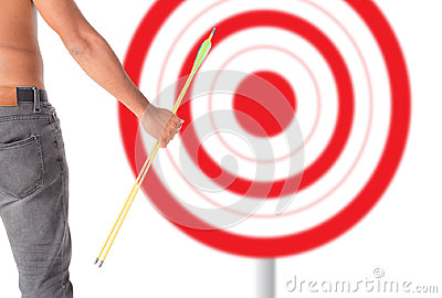 Asian man holding bow and shooting to archery target.